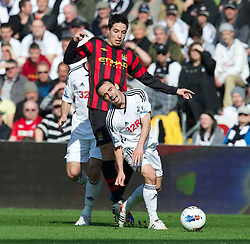 SWANSEA, WALES - Sunday, March 11, 2012: Manchester City's Samir Nasri in action against Swansea City's Leon Britton during the Premiership match at the Liberty Stadium. (Pic by David Rawcliffe/Propaganda)