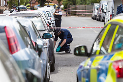 Police conduct a fingertip search of Adolphus Street where seven-year-old Joel Urhie died in a suspected arson attack on his home in Deptford in the early hours of Tuesday 7th August. London, August 08 2018.