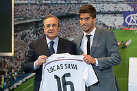 Real Madrid´s President Florentino Perez (L) and Brazil international soccer player Lucas Silva during his official presentation at the Santiago Bernabeu stadium in Madrid, Spain. May 26, 2013. (ALTERPHOTOS/Victor Blanco)