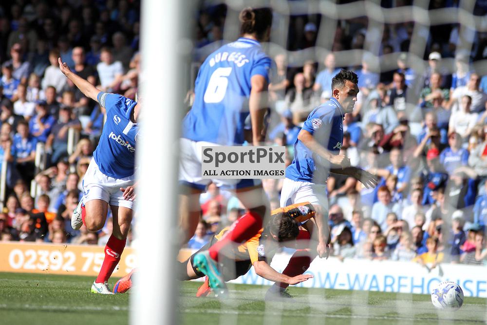Luke Gambin fouled in the box During Portsmouth vs Barnet on Saturday 12th September 2015.
