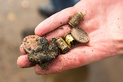 © Licensed to London News Pictures. 06/03/2018. Scarborough UK. Picture shows what appear to be bullet cartridges found by a metal detector on the beach in Scarborough that has been left with no sand after storm Emma. Photo credit: Andrew McCaren/LNP