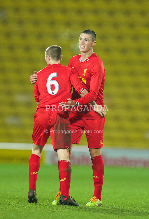 WATFORD, ENGLAND - Wednesday, February 19, 2014: Liverpool's Jordan Williams celebrates his side's 2-0 victory over Watford during the FA Youth Cup 5th Round match at Vicarage Road. (Pic by David Rawcliffe/Propaganda)