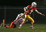 Marion's Trevor Hardman (7) spins away from Western Dubuque's Bryce Hoerner (55) during their first round playoff game at Thomas Park Field in Marion on Wednesday, October 24, 2012.