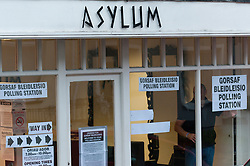 © Licensed to London News Pictures. 08/06/2017. Merthyr Tydfil, Mid Glamorgan, Wales, UK. A hair salon named Asylum serves as a polling station. Damp and drizzly weather in the old mining town of Merthyr Tydfil as the polling tations open at 7.00am on the day of the general election in Wales, UK. Photo credit: Graham M. Lawrence/LNP
