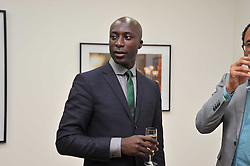 OZWALD BOATENG at a private view of Alison Jackson's photographs 'Up The Aisle' held at the Ben Brown gallery 12 Brook's Mews, London W1 on 19th April 2011.