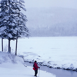 Snowshoeing along the shores of Second Connecticut Lake.  Northern Forest.  Winter sports.  Pittsburg, NH