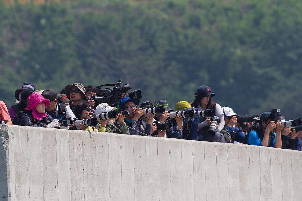 Spectators watch the final at the 2011 Korea Match Cup. Gyeonggi Province, Korea. 12 June 2011. Photo: Subzero Images/Korea Match Cup