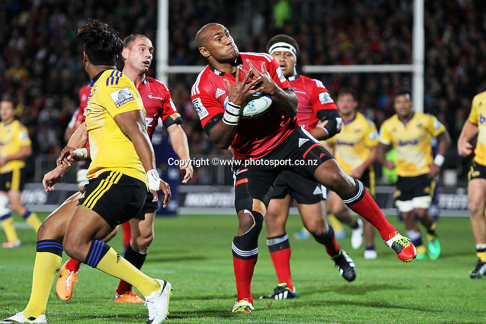 Nemani Nadolo of the Crusaders takes a high kick during the Investec Super Rugby match between Crusaders v Hurricanes at AMI Stadium, Christchurch. 28 March 2014 Photo: Joseph Johnson/www.photosport.co.nz