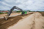 Volvo EC380E crawler excavator modified to work on flood protection in the dutch Cortenoever. Photo: Erik Luntang