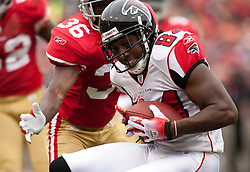 October 11, 2009; San Francisco, CA, USA;  Atlanta Falcons wide receiver Roddy White (84) makes a catch in front of San Francisco 49ers defensive back Shawntae Spencer (36) in the first quarter at Candlestick Park. Atlanta won 45-10.