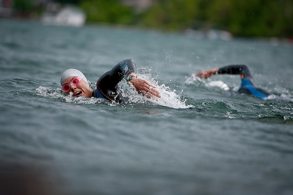JEROME A. POLLOS/Press..Heather and Trevor Wurtele, from Victoria, B.C., swim along the shore of Hayden Lake Tuesday while continuing their training for the upcoming Ironman Coeur d'Alene. Heather Wurtele was the top female finisher of last year's Ironman Coeur d'Alene.