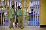 Prisoner leaving E wing through an internal security gate. HMP Wandsworth, London, United Kingdom
