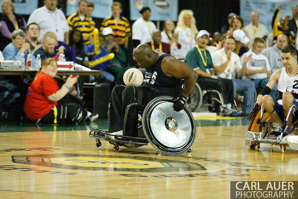 July 7th, 2006: Anchorage, AK - Johnny Holland (6) rolls down the floor as White defeated Blue in the gold medal game of Quad Rugby at the 26th National Veterans Wheelchair Games.