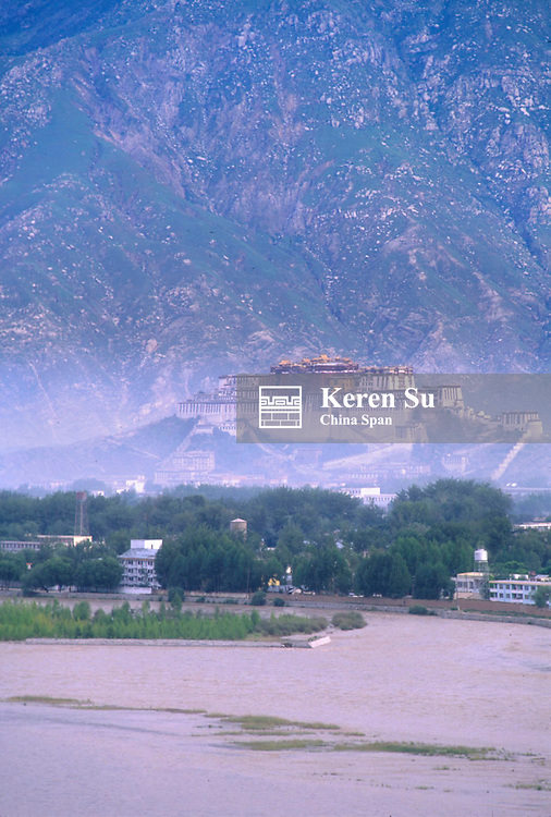 Potala Palace sitting on a hill in mist with Lhasa River in the front, Lhasa, Tibet, China