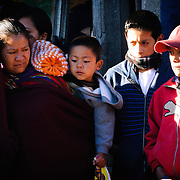 A family watches the performance as part of the Convite de 12 Dicembre in Chichicastengo. . Chichicastenango is an indigenous Maya town in the Guatemalan highlands about 90 miles northwest of Guatemala City and at an elevation of nearly 6,500 feet. It is most famous for its markets on Sundays and Thursdays.