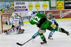 Petr Sachl (HDD Tilia Olimpija, #12) vs Alex Westlund (EHC Liwest Linz, #32) during ice-hockey match between HDD Tilia Olimpija and EHC Liwest Black Wings Linz in 51st Round of EBEL league, on Februar 5, 2012 at Hala Tivoli, Ljubljana, Slovenia. (Photo By Matic Klansek Velej / Sportida)
