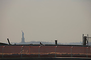 statue of liberty seen from down town Brooklyn after pier 1 is demolished