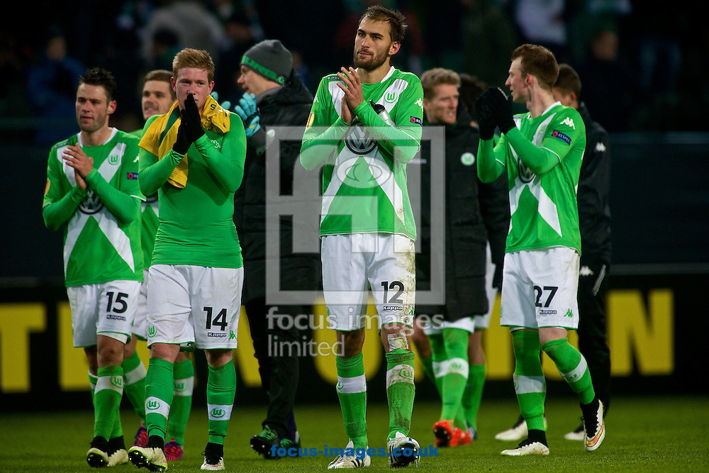 Bas Dost of VfL Wolfsburg (centre) acknowledges fans following the UEFA Europa League match at Volkswagen Arena, Wolfsburg<br /> Picture by Ian Wadkins/Focus Images Ltd +44 7877 568959<br /> 19/02/2015