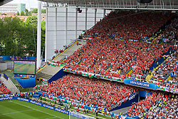 LENS, FRANCE - Thursday, June 16, 2016: Wales supporters celebrate their opening goal during the UEFA Euro 2016 Championship Group B match against England at the Stade Bollaert-Delelis. (Pic by Paul Greenwood/Propaganda)