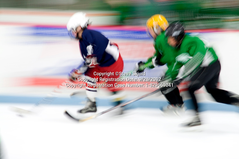 Blurred image of boys age 10 playing hockey. Braemar Hockey Arena Edina Minnesota MN USA