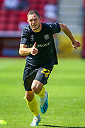 Brentford defender Henrik Dalsgaard (22) warms up during the EFL Sky Bet Championship match between Charlton Athletic and Brentford at The Valley, London, England on 24 August 2019.