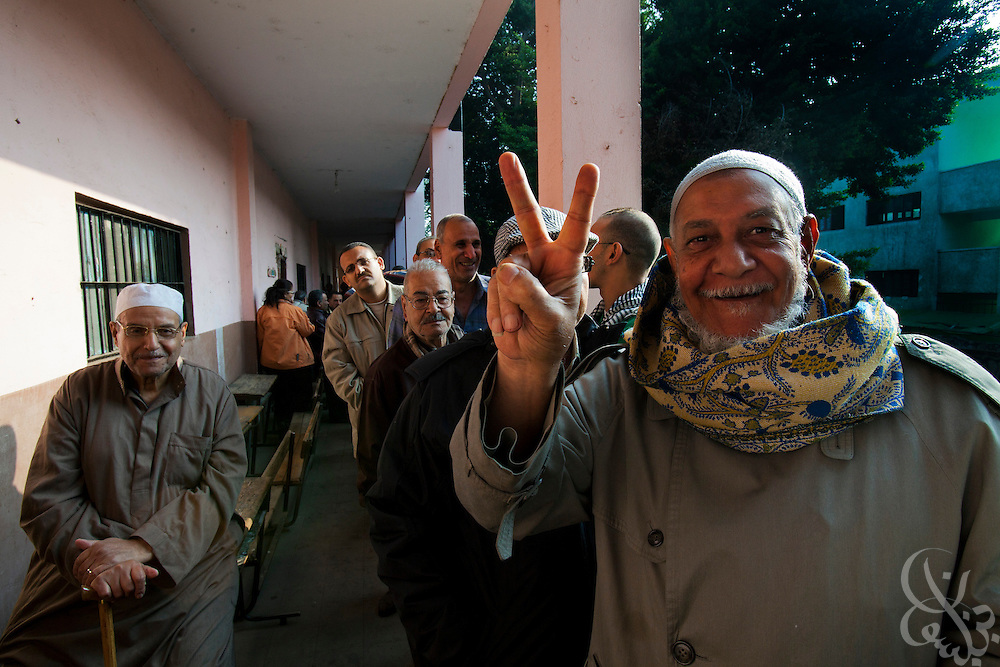 Jubilant Egyptian voters cue in a line as they wait to take part in a historic free parliamentary election Nov 28, 2011 at a polling station in the Shubra district of the capital, Cairo. The first round of voting (1 of three) for the election, the first since the revolution in Egypt that ousted former president Hosni Mubarak earlier in the year, saw very high voter turnout and is hoped to be a positive step in the direction of a new democratic spirit for the country. (Photo by Scott Nelson)