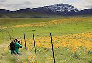 Photographer along the Rocky Mountain Front, Montana.