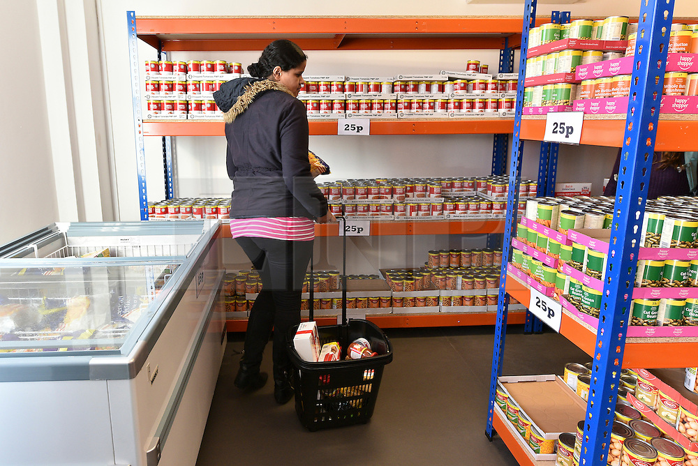 © Licensed to London News Pictures. 02/02/2016. London, UK. A customer shopping inside the store at The new easyFoodstore budget Supermarket in Park Royal, north London which is selling a range of food products all at 25p each. The discount shop, which is owned by the EasyJet company, offers shoppers groceries ranging from pasta to beans to cleaning products. Fresh meat, fruit and vegetables are not yet available. Photo credit: Ray Tang/LNP