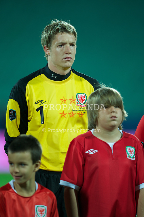 SOFIA, BULGARIA - Tuesday, October 11, 2011: Wales' goalkeeper Wayne Hennessey and mascot Morgan French-Symonds before the UEFA Euro 2012 Qualifying Group G match against Bulgaria at the Vasil Levski National Stadium. (Pic by David Rawcliffe/Propaganda)
