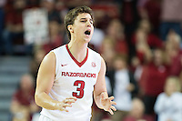 FAYETTEVILLE, AR - MARCH 4:  Dusty Hannahs #3 of the Arkansas Razorbacks yells to the bench during a game against the Georgia Bulldogs at Bud Walton Arena on March, 2017 in Fayetteville, Arkansas.  The Razorbacks defeated the Bulldogs 85-67.  (Photo by Wesley Hitt/Getty Images) *** Local Caption *** Dusty Hannahs