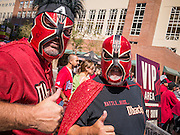 16 SEPTEMBER 2012 - PHOENIX, AZ: Arizona Diamondbacks fans show off their Lucha Libre wrestling masks during Hispanic Heritage Day in Phoenix. The Arizona Diamondbacks hosted their 14th Annual Hispanic Heritage Day, Sunday to kick off Hispanic Heritage Month (Sept. 15-Oct. 15) before the 1:10 p.m. game between the D-backs and San Francisco Giants. The main attraction of the Day was three Lucha Libre USA exhibition wrestling matches in front of Chase Field stadium before the game.  PHOTO BY JACK KURTZ
