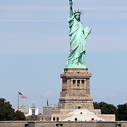 The Statue of Liberty (Liberty Enlightening the World), a colossal neoclassical sculpture on Liberty Island in the middle of New York Harbor, Manhattan. The statue is of a robed female figure representing Libertas, the Roman goddess of freedom, who bears a torch and a tabula ansata