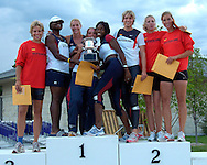 The United States Heptathlon team (center - L-R) Tacita Bass, Reidun Wallin, Danielle McNaney and Lela Nelson pose with team Germany, after defeating Germay in the heptathlon, at the Nike Combined Events Challenge at the R.V. Christian Track Complex on the campus of Kansas State University in Manhattan, Kansas, August 6, 2006.