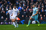 Leeds United midfielder Kalvin Phillips (23) and Queens Park Rangers forward Jordan Hugill (9) during the EFL Sky Bet Championship match between Leeds United and Queens Park Rangers at Elland Road, Leeds, England on 2 November 2019.