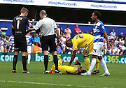 Ryan Mendes (Nottingham Forest striker) getting fouled. This one of many as there was 6 minutes of injury time during the Sky Bet Championship match between Queens Park Rangers and Nottingham Forest at the Loftus Road Stadium, London, England on 12 September 2015. Photo by Matthew Redman.