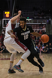 Colorado's Tre'Shaun Fletcher (10) dribbles past  Stanford's Rosco Allen during the first half of an NCAA college basketball game in Stanford, Calif., Sunday, Jan. 3, 2016. (AP Photo/Jason O. Watson)