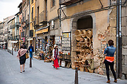 Tourists walking by gifts and souvenirs shops in Calle Marques del Arco, Segovia, Spain