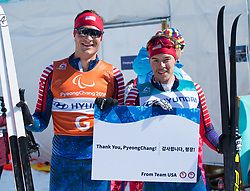 March 17, 2018 - Pyeongchang, South Korea - Jake Adicoff, right, and guide Sawyer Kesselheim after winning the silver medal for the 10km Cross Country Visually Impaired event Saturday, March 17, 2018 at the Pyeongchang Winter Paralympic Games. Photo by Mark Reis (Credit Image: © Mark Reis via ZUMA Wire)