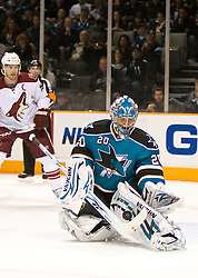 April 10, 2010; San Jose, CA, USA; San Jose Sharks goalie Evgeni Nabokov (20) makes a save against the Phoenix Coyotes during the first period at HP Pavilion.  San Jose defeated Phoenix 3-2 in a shootout. Mandatory Credit: Jason O. Watson / US PRESSWIRE