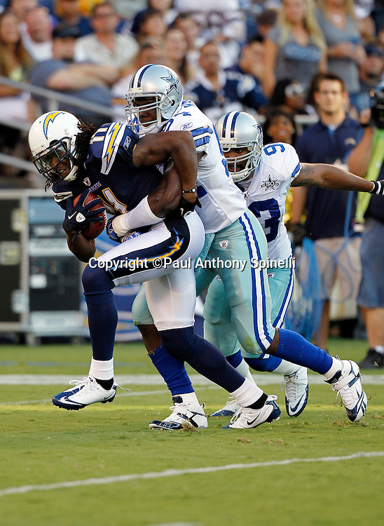 San Diego Chargers wide receiver Legedu Naanee (11) catches a pass and gets tackled by Dallas Cowboys linebackers DeMarcus Ware (94) and Anthony Spencer (93) during a NFL week 2 preseason football game against the Dallas Cowboys on Saturday, August 21, 2010 in San Diego, California. The Cowboys won the game 16-14. (©Paul Anthony Spinelli)