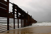 The border fence seperating the U.S. from Mexico runs into the Pacific Ocean near San Ysidro, Calif. on Monday, March 28, 2005.<br />