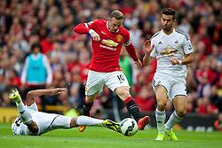 16-08-2014 ENG: Premier League, Manchester United vs Swansea City, Manchester<br /> Wayne Rooney is tackled <br /> <br /> ***NETHERLANDS ONLY***