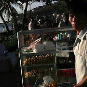 """Vendors await customers on the beach in Vung Tau, Vietnam, a popular beach resort a few hours' drive from Ho Chi Minh City. Former glam rock star Gary Glitter is currently behind bars in the resort town, facing charges of child molestation. Glitter, whose real name is Paul Gadd, was convicted in Britain in 1999 of possessing child pornography and served two months in jail. In 2002 he was kicked out of Cambodia, a country with lax regulation of prostitution. Glitter's 1970's hit """"Rock and Roll (Part 2)""""  is played regularly at sporting events throughout North America and Europe."""