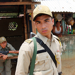 Indian law enforcement officers from Manipur Police Force guarding a village on Highway 53 in the Tamenglong district of the troubled Indian state of Manipur
