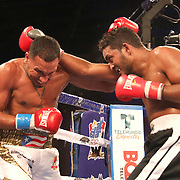 Gerald Semidy (L) fights Yasmani Pedroso during a Telemundo boxing match at Osceola Heritage Park on Friday, July 20, 2018 in Kissimmee, Florida.  (Alex Menendez via AP)