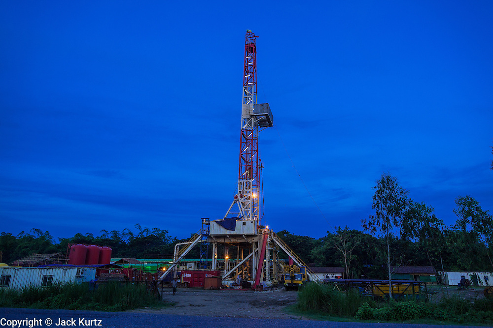 06 JUNE 2014 - IRRAWADDY DELTA,  AYEYARWADY REGION, MYANMAR:  A natural gas well near Yandon in the Irrawaddy Delta (or Ayeyarwady Delta) of Myanmar. Natural gas exploration is becoming common in the area. The region is Myanmar's largest rice producer, so its infrastructure of road transportation has been greatly developed during the 1990s and 2000s. Two thirds of the total arable land is under rice cultivation with a yield of about 2,000-2,500 kg per hectare. FIshing and aquaculture are also important economically. Because of the number of rivers and canals that crisscross the Delta, steamship service is widely available.  PHOTO BY JACK KURTZ