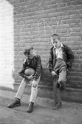 Gary and Neville Leaning on Wall, High Wycombe, UK, 1980s.