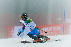 Forerunner competing in the Alpine Skiing Super Combined Slalom at the 2014 Sochi Winter Paralympic Games, Russia