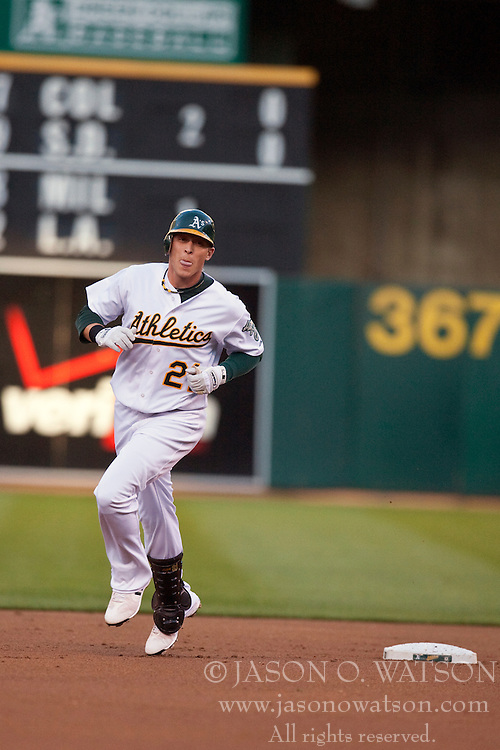 May 4, 2010; Oakland, CA, USA;  Oakland Athletics right fielder Ryan Sweeney (21) after hitting a two run home run during the first inning against the Texas Rangers at Oakland-Alameda County Coliseum. Oakland defeated Texas 7-6.
