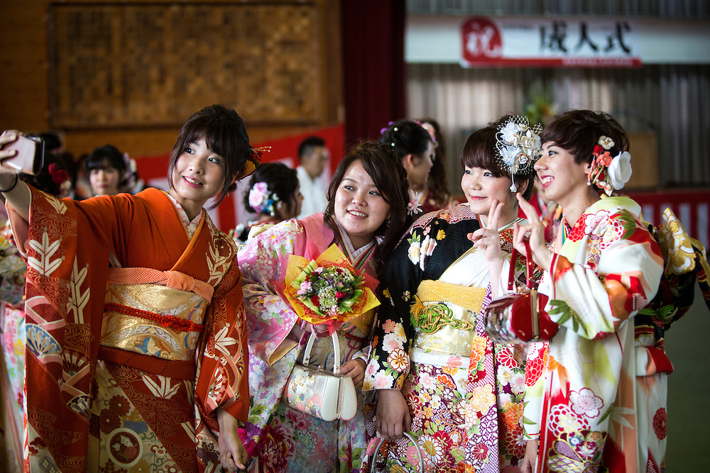 OKINAWA, JAPAN - JANUARY 8 : New adults in kimonos takes photos after attending a Coming of Age Day celebration ceremony in Shuri Junior High School in Okinawa, Japan on January 8, 2017. The Coming of Age Day, one of the Japanese national holidays, is the day to celebrate young people who have reached the age of 20, the age of maturity in Japan, when they are legally permitted to smoke, drink alcohol and vote. (Photo by Richard Atrero de Guzman/NURPhoto)